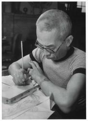 撮影・土門拳《面相筆で線を引くフジタ》1941年