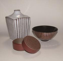 鉄軸を使った器や花器(近藤圭)