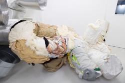 「カプセル」 素材:自分がいままで着た服 ダクト(アルミ トタン) サイズ:可変 制作年:2019年